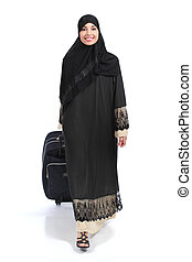 Full body of an arab saudi woman traveler walking isolated on a white background