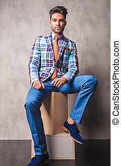 fashion business man sitting on wood boxes