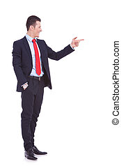 handsome young business man pointing to his side