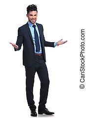 full body picture of a young business man welcoming you on a white background