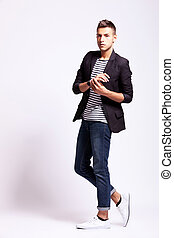 young fashion man in a pose