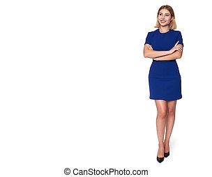 Full body portrait of a beautiful woman in blue dress