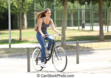 Full body portrait of a cyclist riding in the street