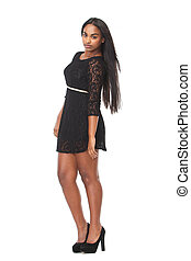 Full body portrait of an attractive young woman in black dress