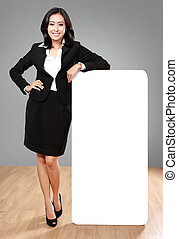 businesswoman holding blank billboard