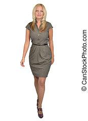Full body portrait of walking business woman