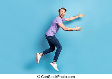 Full body profile photo of astonished crazy person open mouth arms wait catch isolated on blue color background