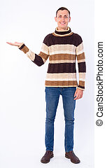 Full body shot of happy man showing something ready for winter