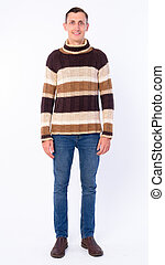 Full body shot of happy man smiling ready for winter