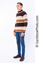 Full body shot of man thinking and looking away ready for winter