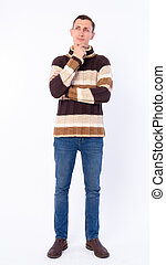 Full body shot of man thinking and looking up ready for winter