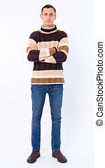 Full body shot of man with arms crossed ready for winter