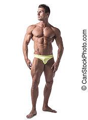 Full body shot of shirtless muscular young man standing
