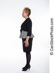 Full body shot profile view of senior Asian businesswoman standi