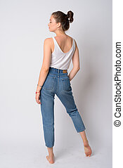 Full body shot rear view of young beautiful woman looking over shoulder