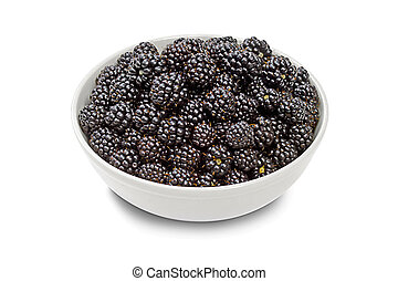 full bowl of blackberries on a white background