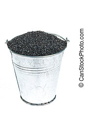 Full bucket of poppy seeds on a white background.