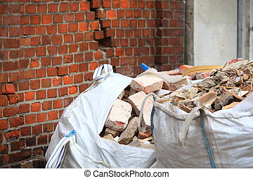 Full construction waste debris bags, garbage bricks and material from demolished house