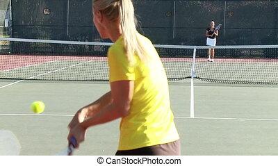 Full court tennis game slow motion