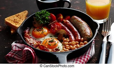 Full English breakfast on dark rusty background - Full...