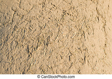 Full Frame Adobe Mud Wall, Rough Straw Texture - Close up of...