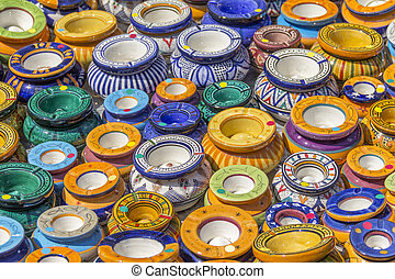 lots of colorful ashtrays