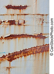 Full Frame Peeling Paint Rust Stains on Gray Metal Surface...