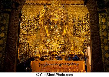 Full front view of the Mahamuni Buddha.