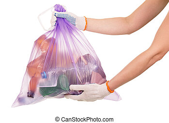Full garbage bag in her hands closeup isolated on white