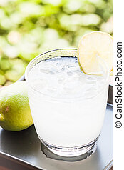 Full glass of fresh cool soda with lime