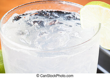 Full glass of fresh cool soda with lime fruit