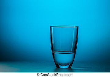 Full glass on blue background