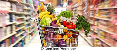 Full grocery cart. - Full shopping grocery cart in...