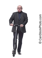 full growth . Mature business man with an electric scooter