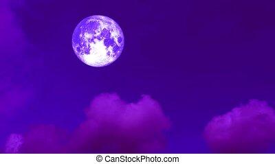 full harvest purple moon moving pass back cloud on dark...