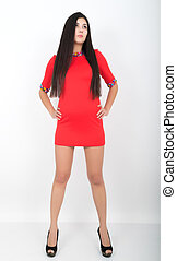 full height a young pretty slim asian woman standing in a little red dress