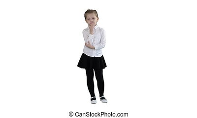 A curious little girl stands and thinks on white background....