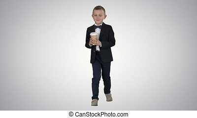 Boy walking with a take away coffee in a formal clothes on gradient background.