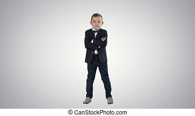 Little boy kid crossing hands in a formal costume on...