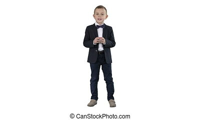 Serious little boy giving a speech to camera on white background.
