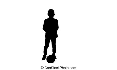 Silhouette Boy in a formal suit kicking football. - Full...
