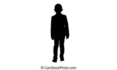 Silhouette Little boy in a costume with a bow tie walking.