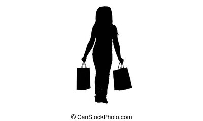 Full lenght shot. Silhouette Little girl with shopping bags walking. Professional shot in 4K resolution. 016. You can use it e.g. in your commercial video, education, business, presentation, broadcast
