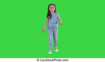 Small girl walking and talking to camera making gestures on...