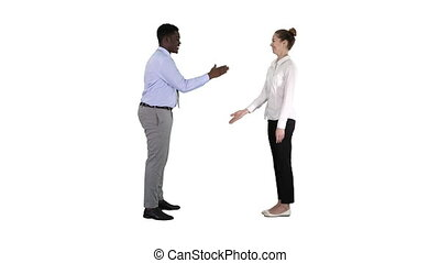 African man and caucasian woman giving low five on white...