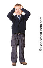 Full-length amazed or surprised child boy holds her head,...