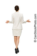 Full-length backview of business woman with outstretched arms