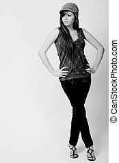 Full length black and white image of a brunette model