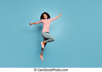 Full length body size photo of cheerful cute charming nice funky girlfriend jumping up with hands raised wearing trousers pants isolated over pastel color background