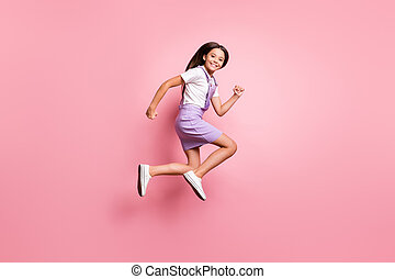 Full length body size profile side view of her she nice attractive lovely purposeful glad cheerful cheery long-haired girl jumping running isolated over pink pastel color background